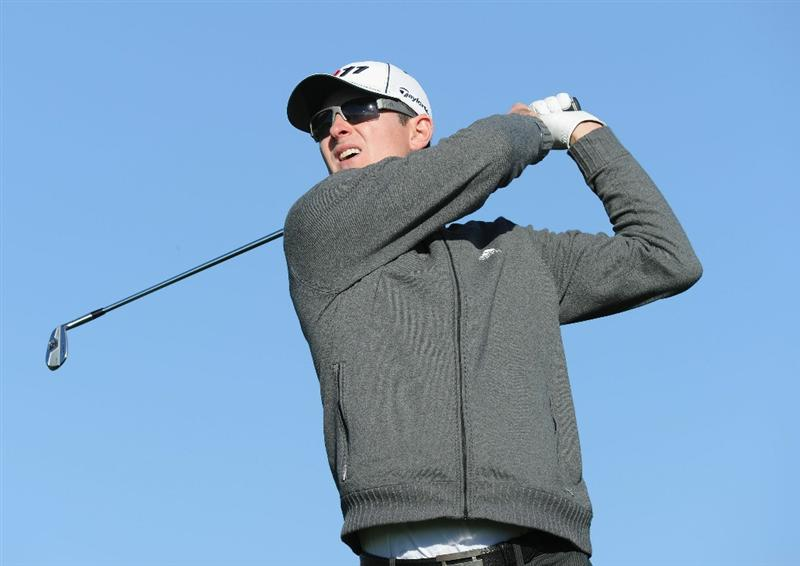 MARANA, AZ - FEBRUARY 24:  Justin Rose of England plays his approach on the first playoff  hole during the second round of the Accenture Match Play Championship at the Ritz-Carlton Golf Club on February 24, 2011 in Marana, Arizona.  (Photo by Stuart Franklin/Getty Images)