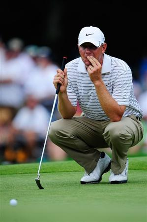 CHASKA, MN - AUGUST 15:  Lucas Glover lines up his putt on the 11th green during the third round of the 91st PGA Championship at Hazeltine National Golf Club on August 15, 2009 in Chaska, Minnesota.  (Photo by Sam Greenwood/Getty Images)