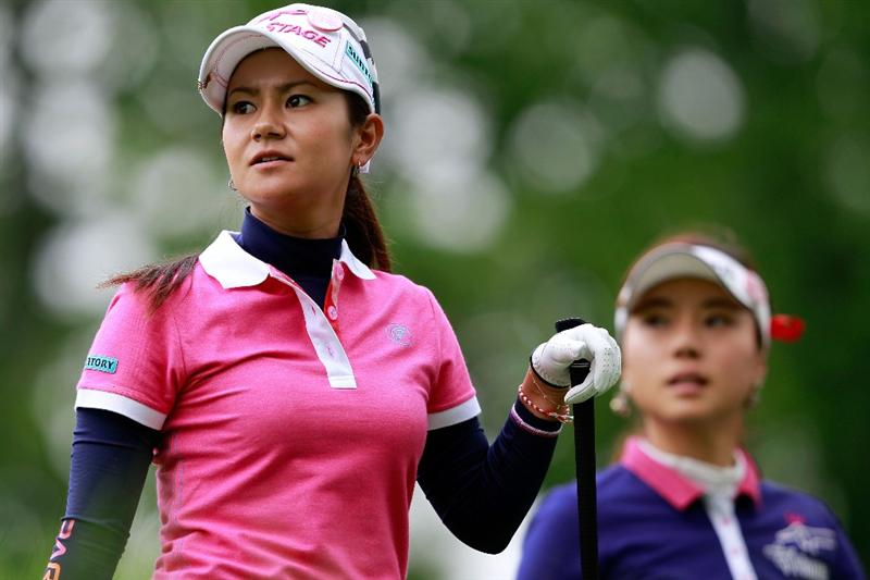 GLADSTONE, NJ - MAY 19:  (L) Ai Miyazato of Japan watches her tee shot on the third hole during her match against (R) Hee Young Park of South Korea during round one of the Sybase Match Play Championship at Hamilton Farm Golf Club on May 19, 2011 in Gladstone, New Jersey.  (Photo by Chris Trotman/Getty Images)