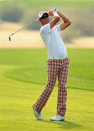DUBAI, UNITED ARAB EMIRATES - FEBRUARY 11:  Fredrik Andersson Hed of Sweden hits his second shot on the 16th hole during the second round of the Omega Dubai Desert Classic on the Majlis course at the Emirates Golf Club on February 11, 2011 in Dubai, United Arab Emirates.  (Photo by Andrew Redington/Getty Images)