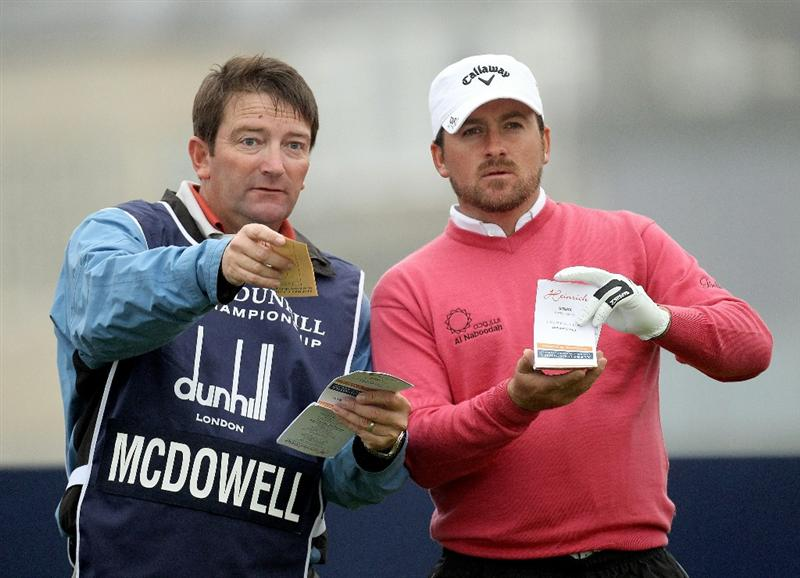 ST ANDREWS, SCOTLAND - OCTOBER 08:  Graeme McDowell of Northern Ireland with his caddie on thr second tee  during the second round of The Alfred Dunhill Links Championship at The Old Course on October 8, 2010 in St Andrews, Scotland.  (Photo by Ross Kinnaird/Getty Images)