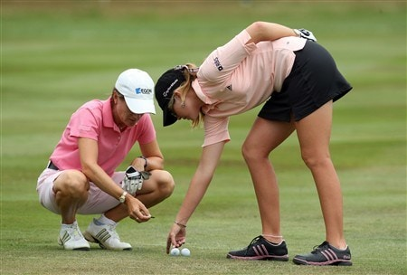 SUNNINGDALE, UNITED KINGDOM - JULY 31:  Catriona Matthew of Scotland prepares to mark her ball on the fairway after her tee shot had finished almost touching the drive of her playing partner Paula Creamer of the USA (right) at the first hole during the first round of the 2008  Ricoh Women's British Open Championship held on the Old Course at Sunningdale Golf Club, on July 31, 2008 in Sunningdale, England.  (Photo by David Cannon/Getty Images)