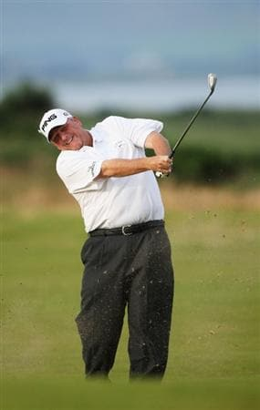 TURNBERRY, SCOTLAND - JULY 16:  Mark Calcavecchia of USA hits an approach shot on the 2nd hole during round one of the 138th Open Championship on the Ailsa Course, Turnberry Golf Club on July 16, 2009 in Turnberry, Scotland.  (Photo by Andrew Redington/Getty Images)