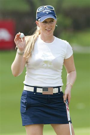 CHON BURI, THAILAND - FEBRUARY 17:  Morgan Pressel of USA acknowledges the crowd on 15th green during day one of the LPGA Thailand at Siam Country Club on February 17, 2011 in Chon Buri, Thailand.  (Photo by Victor Fraile/Getty Images)