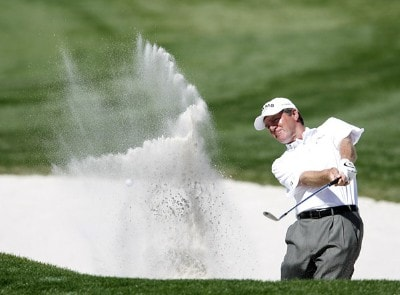 Des Smyth blasts out of the sand trap in front of the 18th green during the first round of the 2007 ACE Group Classic Friday, February 23, 2007, at Quail West in Naples, Florida. Champions Tour - The 2007 ACE Group Classic - First RoundPhoto by Kevin C.  Cox/WireImage.com