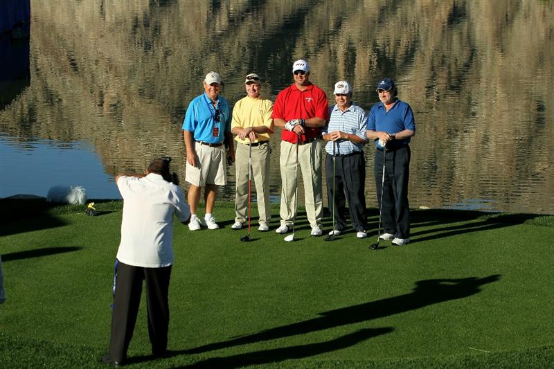 LA QUINTA, CA - JANUARY 21:  Chris Couch (in red) poses with his amateur team on the tenth tee during round three of the Bob Hope Classic at the Palmer Private Course at PGA West on January 21, 2011 in La Quinta, California.  (Photo by Stephen Dunn/Getty Images)