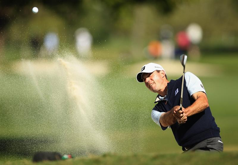 DORAL, FL - MARCH 11:  Matt Kuchar plays a bunker shot on the fifth hole during the second round of the 2011 WGC- Cadillac Championship at the TPC Blue Monster at the Doral Golf Resort and Spa on March 11, 2011 in Doral, Florida.  (Photo by Mike Ehrmann/Getty Images)