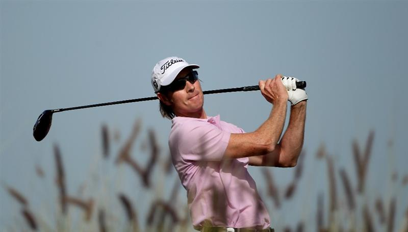 DOHA, QATAR - JANUARY 30:  Brett Rumford of Australia hits his tee-shot on the ninth hole during the third round of the Commercialbank Qatar Masters at Doha Golf Club on January 30, 2010 in Doha, Qatar.  (Photo by Andrew Redington/Getty Images)