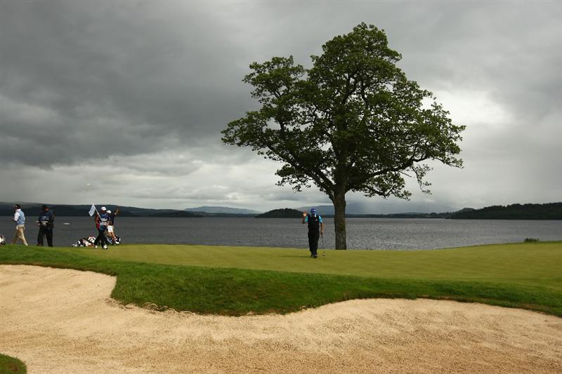 LUSS, SCOTLAND - JULY 12:  Retief Goosen of South Africa acknowledges the crowd on the 6th green  during the Final Round of The Barclays Scottish Open at Loch Lomond Golf Club on July 12, 2009 in Luss, Scotland.  (Photo by Richard Heathcote/Getty Images)