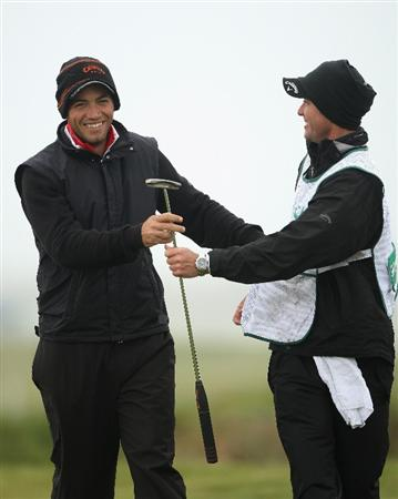 BALTRAY, IRELAND - MAY 16:  Nick Dougherty of England shares a joke with his caddie Michael Kerr (R) on the first hole during the third round of The 3 Irish Open at County Louth Golf Club on May 16, 2009 in Baltray, Ireland.  (Photo by Andrew Redington/Getty Images)