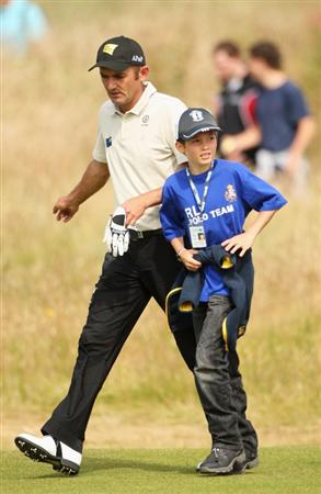 TURNBERRY, SCOTLAND - JULY 15:  Markus Brier of Austria walks with his son Constantin during a practice round prior to the 138th Open Championship on the Ailsa Course, Turnberry Golf Club on July 15, 2009 in Turnberry, Scotland.  (Photo by Andrew Redington/Getty Images)