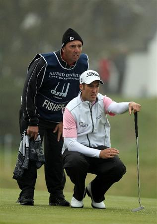 ST ANDREWS, SCOTLAND - OCTOBER 08:  Ross Fisher of England lines up a putt with his caddie on the 17th green during the second round of The Alfred Dunhill Links Championship at The Old Course on October 8, 2010 in St Andrews, Scotland.  (Photo by Ross Kinnaird/Getty Images)