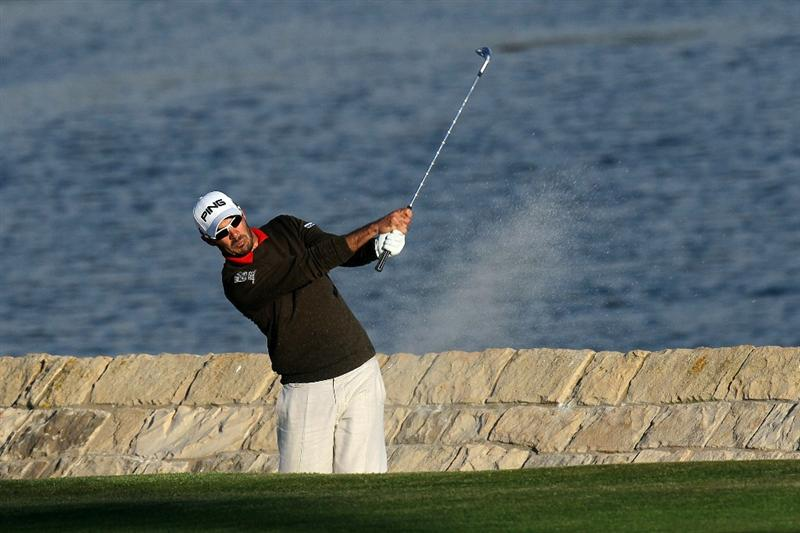 PEBBLE BEACH, CA - JUNE 19:  Gregory Havret of France hits a bunker shot on the 18th hole during the third round of the 110th U.S. Open at Pebble Beach Golf Links on June 19, 2010 in Pebble Beach, California.  (Photo by Stephen Dunn/Getty Images)