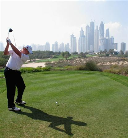 DUBAI, UNITED ARAB EMIRATES - FEBRUARY 10:  Paul Lawrie of Scotland hits his tee-shot on the eighth hole during the first round of the Omega Dubai Desert Classic on the Majlis course at the Emirates Golf Club on February 10, 2011 in Dubai, United Arab Emirates.  (Photo by Andrew Redington/Getty Images)