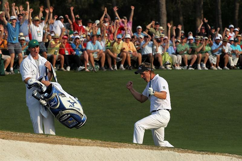 AUGUSTA, GA - APRIL 10:  Luke Donald of England celebrates after holing a pitch shot for birdie on the 18th hole as his caddie John McLaren look on during the final round of the 2011 Masters Tournament at Augusta National Golf Club on April 10, 2011 in Augusta, Georgia.  (Photo by Jamie Squire/Getty Images)