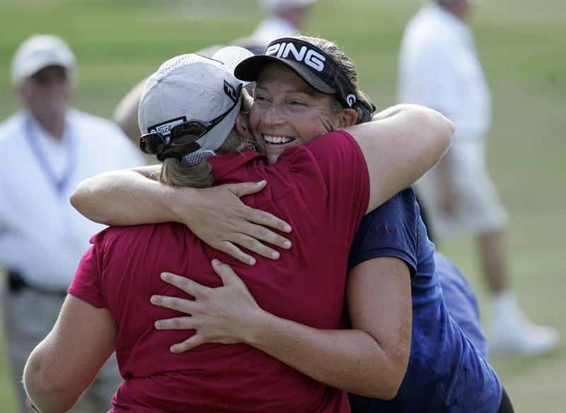 MOBILE, AL - SEPTEMBER 14:  Angela Stanford is hugged by Katherine Hull of Australia after Stanford won the Bell Micro LPGA Classic at Magnolia Grove Golf Course on September 14, 2008 in Mobile, Alabama.  (Photo by Dave Martin/Getty Images)