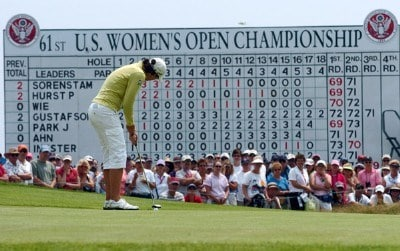 Julie Inkster putts  on the 18th green  during the third round  at Newport Country Club, site of the 2006 U. S. Women's Open in Newport, Rhode Island, July 2.Photo by Al Messerschmidt/WireImage.com