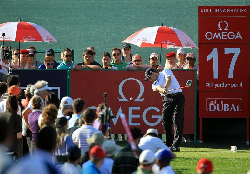 DUBAI, UNITED ARAB EMIRATES - FEBRUARY 12:  Sergio Garcia of Spain plays his tee shot on the par 4, 17th hole during the third round of the 2011 Omega Dubai Desert Classic on the Majilis Course at the Emirates Golf Club on February 12, 2011 in Dubai, United Arab Emirates.  (Photo by David Cannon/Getty Images)