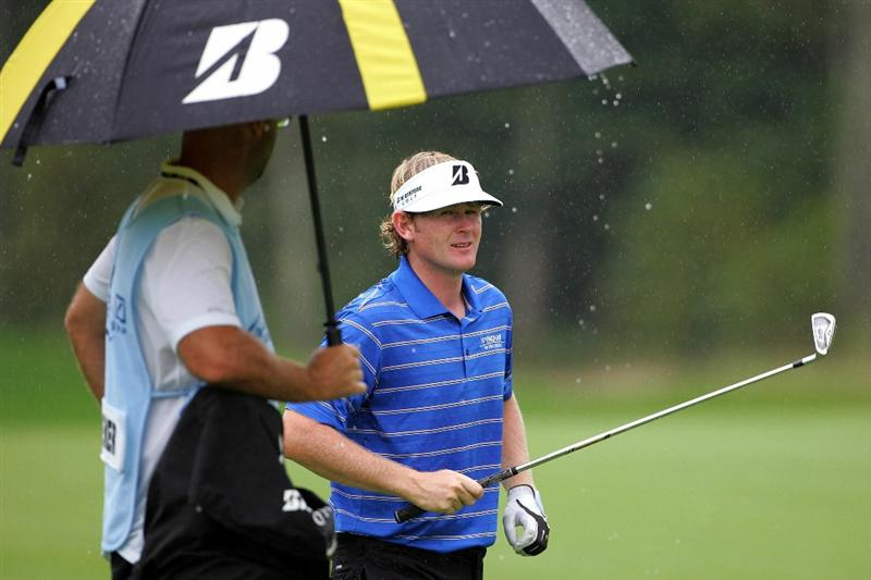 NORTON, MA - SEPTEMBER 03:  Brandt Snedeker reacts in the rain after hitting a shot on ninth fairway during the first round of the Deutsche Bank Championship at TPC Boston on September 3, 2010 in Norton, Massachusetts.  (Photo by Michael Cohen/Getty Images)