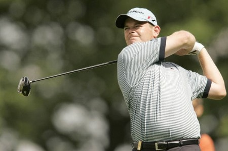 Damien McGrane watches his tee shot during the rain delayed first round of the 2005 Deutsche Bank Players' Championship at Gut Kaden Golf Club in Hamburg, Germany on July 22, 2005.Photo by Pete Fontaine/WireImage.com
