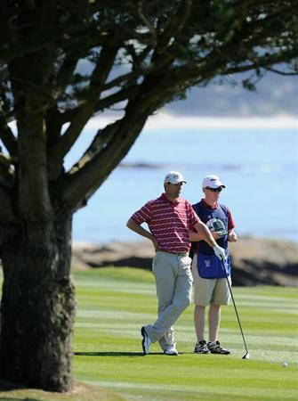 PEBBLE BEACH, CA - FEBRUARY 11:  Padraig Harrington of Ireland with his caddie Ronan Flood on the18th hole during the second round of the AT&T Pebble Beach National Pro-Am at the Pebble Beach Golf Links on February 11, 2011  in Pebble Beach, California  (Photo by Stuart Franklin/Getty Images)