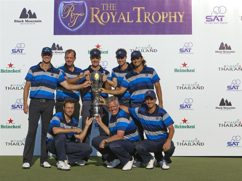 HUA HIN, THAILAND - JANUARY 09:  (Front row L-R) Pablo Martin of Spain, Colin Montgomerie of Scotland, Matteo Manassero of Italy, (Back row L-R) Peter Hanson of Sweden,  Henrik Stenson of Sweden, Rhys Davies of Wales, Johan Edfors of Sweden and Fredrik Andersson Hed of Sweden pose with the Royal Trophy after winning the Royal Trophy tournament at Black Mountain Golf Club on January 9, 2011 in Hua Hin, Thailand.  (Photo by Athit Perawongmetha/Getty Images)