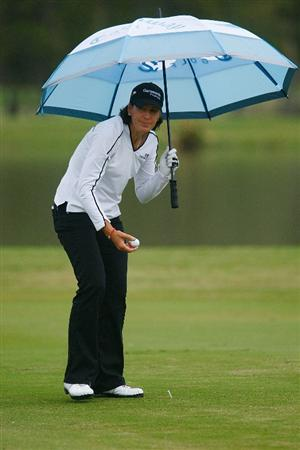 RICHMOND, TX - NOVEMBER 20:  Juli Inkster waits under an umbrella on the 13th hole during the second round of the LPGA Tour Championship presented by Rolex at the Houstonian Golf and Country Club on November 20, 2009 in Richmond, Texas.  (Photo by Scott Halleran/Getty Images)