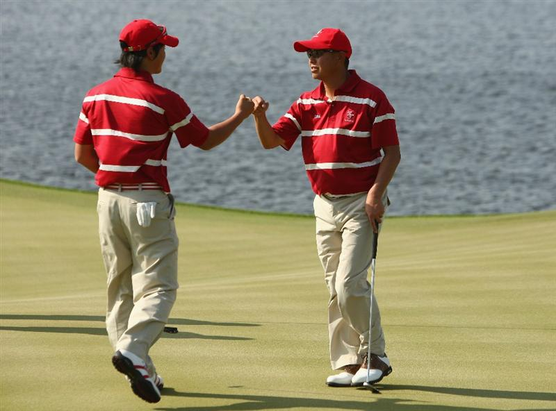 BANGKOK, THAILAND - JANUARY 09:  Ryo Lshikawa of Japan and Toru Taniguchi of Japan celebrate during the foursomes on Day one of The Royal Trophy at the Amata Spring Country Club on January 9, 2009 in Bangkok, Thailand.  (Photo by Ian Walton/Getty Images)