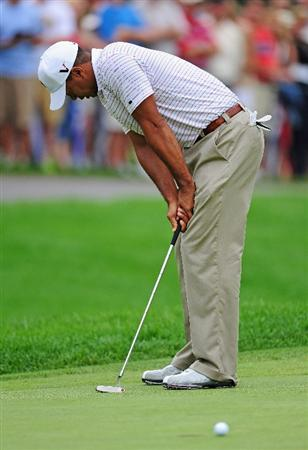 AKRON, OH - AUGUST 08:  Tiger Woods of USA reacts to his putt on the first hole during the third round of the World Golf Championship Bridgestone Invitational on August 8, 2009 at Firestone Country Club in Akron, Ohio.  (Photo by Stuart Franklin/Getty Images)