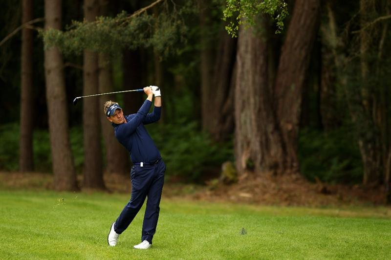 VIRGINIA WATER, ENGLAND - MAY 27:  Luke Donald of England hits his 2nd shot on the 12th hole during the second round of the BMW PGA Championship at the Wentworth Club on May 27, 2011 in Virginia Water, England.  (Photo by Richard Heathcote/Getty Images)