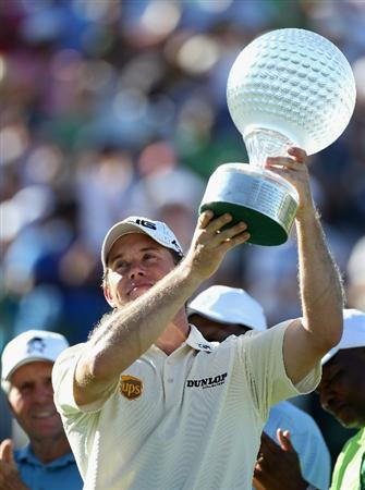 SUN CITY, SOUTH AFRICA - DECEMBER 05:  Lee Westwood of England raises the trophy after winning the 2010 Nedbank Golf Challenge at the Gary Player Country Club Course  on December 5, 2010 in Sun City, South Africa.  (Photo by Warren Little/Getty Images)