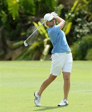 SINGAPORE - FEBRUARY 27:  Karrie Webb of Australia hits her second shot on the 17th hole during the final round of the HSBC Women's Champions at the Tanah Merah Country Club on February 27, 2011 in Singapore.  (Photo by Andrew Redington/Getty Images)