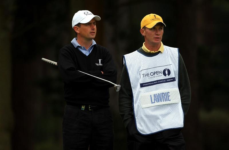 SUNNINGDALE, ENGLAND - JUNE 08:  Peter Lawrie of Irelandwaits with his caddie Dermot Byrne on the first hole of the Old Course during the morning's play at The Open Championship International Final Qualifying on June 8, 2009 at Sunningdale Golf Club in Sunningdale, England.  (Photo by Andrew Redington/Getty Images)