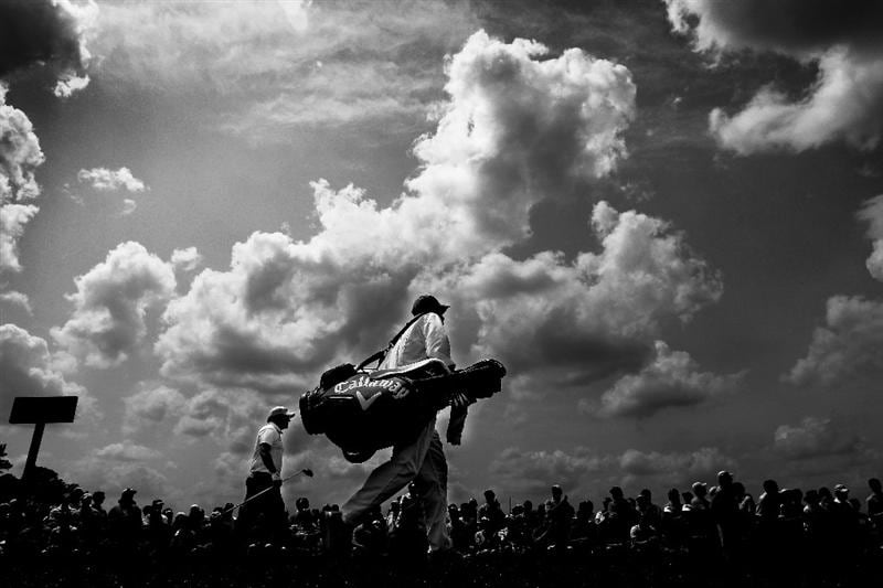 AUGUSTA, GA - APRIL 09:  (EDITORS NOTE: Image has been converted to black and white.)  Phil Mickelson walks off the first tee with his caddie Jim Mackay during the third round of the 2011 Masters Tournament at Augusta National Golf Club on April 9, 2011 in Augusta, Georgia.  (Photo by Jamie Squire/Getty Images)