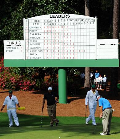 AUGUSTA, GA - APRIL 11:  Kenny Perry watches as Chad Campbell hits a putt on the tenth green during the third round of the 2009 Masters Tournament at Augusta National Golf Club on April 11, 2009 in Augusta, Georgia.  (Photo by Harry How/Getty Images)