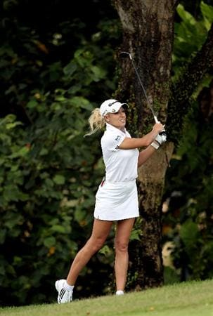 SINGAPORE - FEBRUARY 25:  Natalie Gulbis of the USA hits her second shot on the sixth hole during the first round of the HSBC Women's Champions at the Tanah Merah Country Club on February 25, 2010 in Singapore.  (Photo by Andrew Redington/Getty Images)