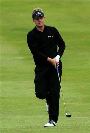 VIRGINIA WATER, ENGLAND - MAY 28:  Luke Donald of England reacts to his 2nd shot on the 4th hole during the third round of the BMW PGA Championship at the Wentworth Club on May 28, 2011 in Virginia Water, England.  (Photo by David Cannon/Getty Images)