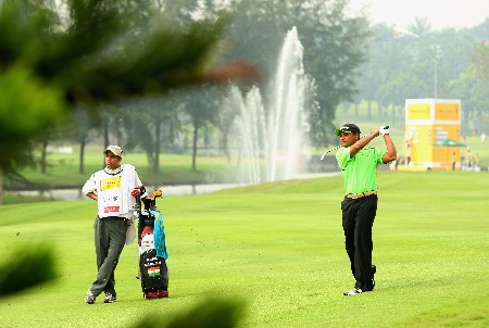 KUALA LUMPUR, MALAYSIA - MARCH 07:  Rahil Gangjee of India hits his second shot on the eighth hole during the second round of the Maybank Malaysian Open held at the Kota Permai Golf & Country Club on March 7, 2008 in Kuala Lumpur, Malaysia.  (Photo by Andrew Redington/Getty Images)