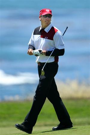 PEBBLE BEACH, CA - JUNE 17:  Ricky Barnes walks across the ninth green during the first round of the 110th U.S. Open at Pebble Beach Golf Links on June 17, 2010 in Pebble Beach, California.  (Photo by Donald Miralle/Getty Images)