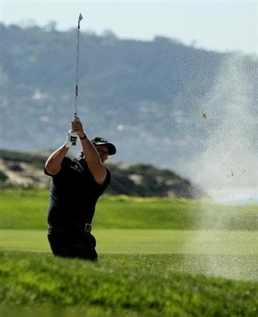 LA JOLLA, CA - JANUARY 27:  Phil Mickelson hits from a fairway bunker on the fifth hole during round one of the Farmers Insurance Open at Torrey Pines North Course on January 27, 2011 in La Jolla, California.  (Photo by Stephen Dunn/Getty Images)
