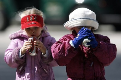 Two young spectators try to keep warm while drinking sodas during the final round of the 2007 Outback Steakhouse Pro-Am Sunday, February 18, 2007, at the TPC of Tampa bay in Tampa, Florida. Champions Tour - 2007 Outback Steakhouse Pro-Am - Final RoundPhoto by Kevin C.  Cox/WireImage.com