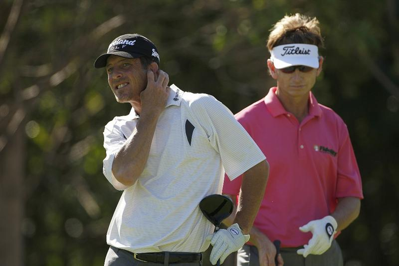 PLAYA DEL CARMEN, MEXICO - FEBRUARY 24:  Jonathan Kaye (L) reacts to his errant drive as Brad Faxon looks on during the first round of the Mayakoba Golf Classic at Riviera Maya-Cancun held at El Camaleon Golf Club on February 24, 2011 in Playa del Carmen, Mexico.  (Photo by Michael Cohen/Getty Images)