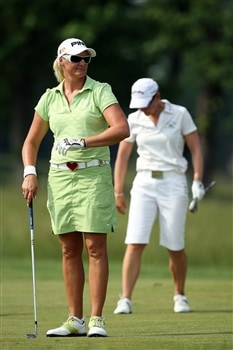 HAVRE DE GRACE, MD - JUNE 08: Maria Hjorth of Sweden prepares to play her third shot as Annika Sorenstam of Sweden finishes repairung her divot during the final round of the 2008 McDonald's LPGA Championship held at Bulle Rock Golf Course, on June 8, 2008 in Havre de Grace, Maryland. (Photo by David Cannon/Getty Images)