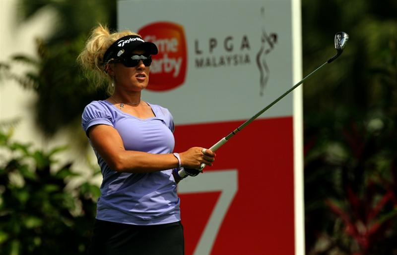 KUALA LUMPUR, MALAYSIA - OCTOBER 21:  Natalie Gulbis of USA watches her tee shot on the 7th hole during the Sime Darby Pro-Am at the KLGCC Golf Course on October 21, 2010 in Kuala Lumpur, Malaysia.  (Photo by Stanley Chou/Getty Images)