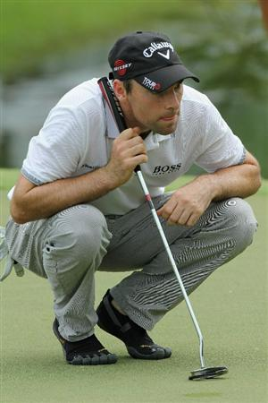 SINGAPORE, NOVEMBER 12 : Oliver Wilson of England lines up a putt on the 7th hole during the second round of the Barclays Singapore Open held at the Sentosa Golf Club on November 12, 2010 Singapore. (Photo by Stanley Chou/Getty Images)