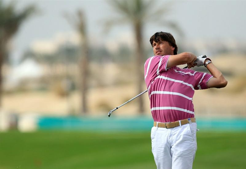 BAHRAIN, BAHRAIN - JANUARY 28:  Robert-Jan Derksen of the Netherlands plays his second shot at the 17th hole during the second round of the 2011 Volvo Champions held at the Royal Golf Club on January 28, 2011 in Bahrain, Bahrain.  (Photo by David Cannon/Getty Images)