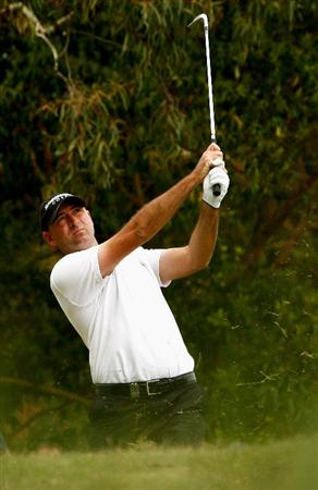MELBOURNE, AUSTRALIA - NOVEMBER 29:  Adam Crawford of Australia plays his second shot on the nineth hole during the third round of the 2008 Australian Masters at Huntingdale Golf Club on November 29, 2008 in Melbourne, Australia  (Photo by Quinn Rooney/Getty Images)