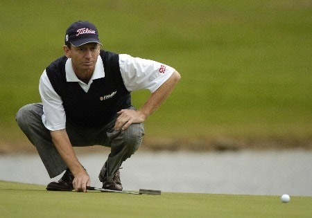 Brad Faxon lines up a putt on the 18th hole  during first-round competition March 3, 2005  at the Ford Championship at Doral in Miami.