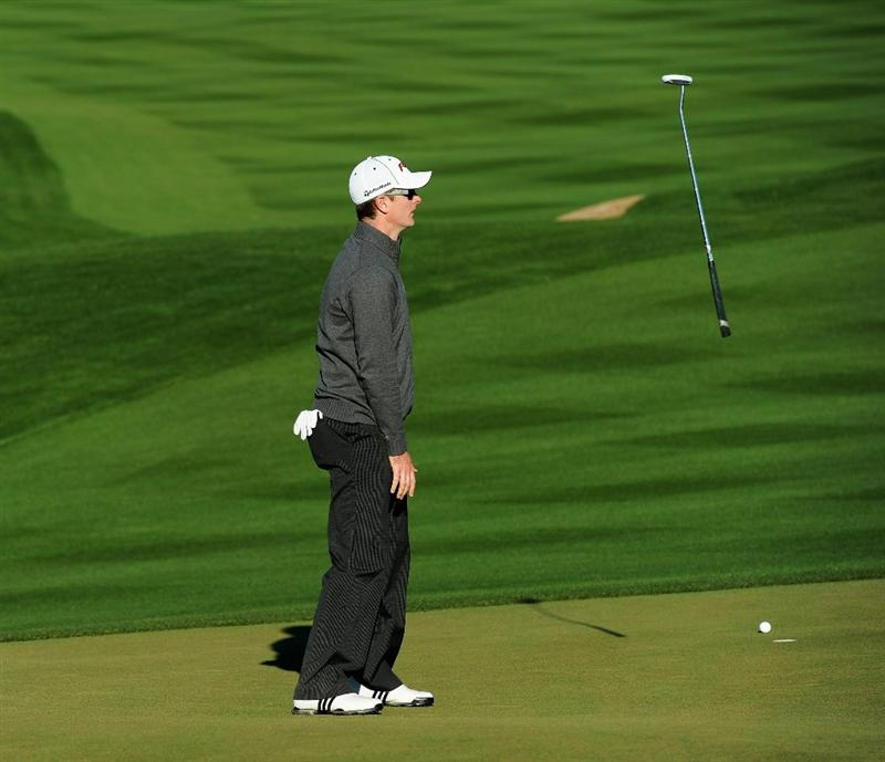 MARANA, AZ - FEBRUARY 24:  Justin Rose of England reacts to his missed putt at the second playoff hole against Martin Kaymer of Germany during the second round of the Accenture Match Play Championship at the Ritz-Carlton Golf Club on February 24, 2011 in Marana, Arizona.  (Photo by Stuart Franklin/Getty Images)