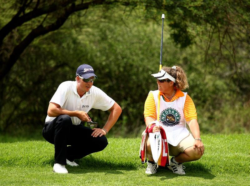 SUN CITY, SOUTH AFRICA - DECEMBER 04:  Henrik Stenson of Sweden talks with caddy Fanny Suneson during the first round of the Nedbank Golf Challenge at the Gary Player Country Club on December 4, 2008 in Sun City, South Africa.  (Photo by Richard Heathcote/Getty Images)